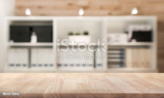 istock Real wood table top texture on interior background. 864378942