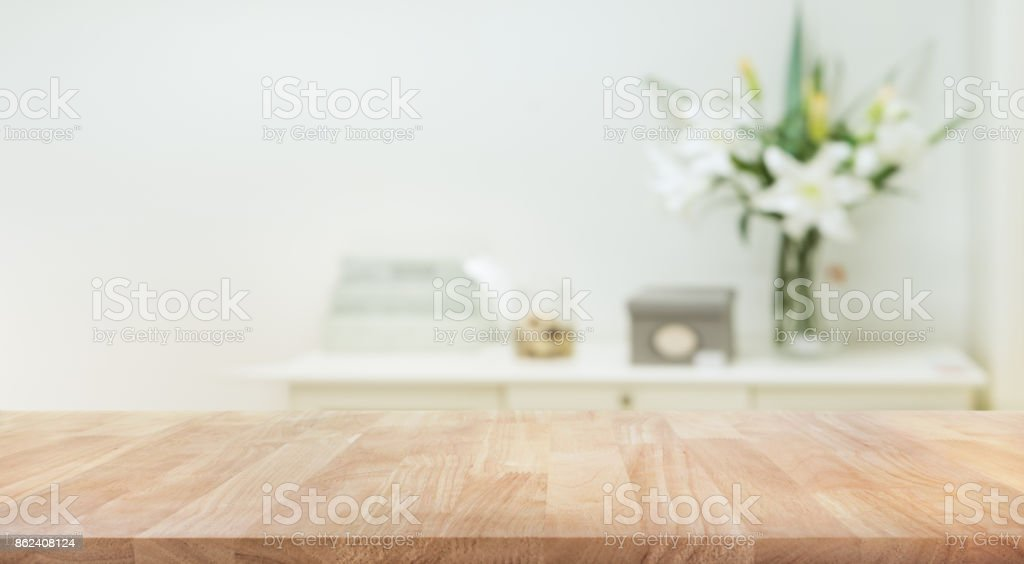Real wood table top texture on white wall room background. stock photo