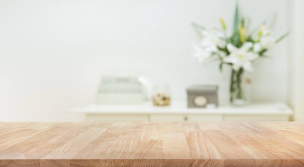 real wood table top texture on white wall room background. - table stock photos and pictures