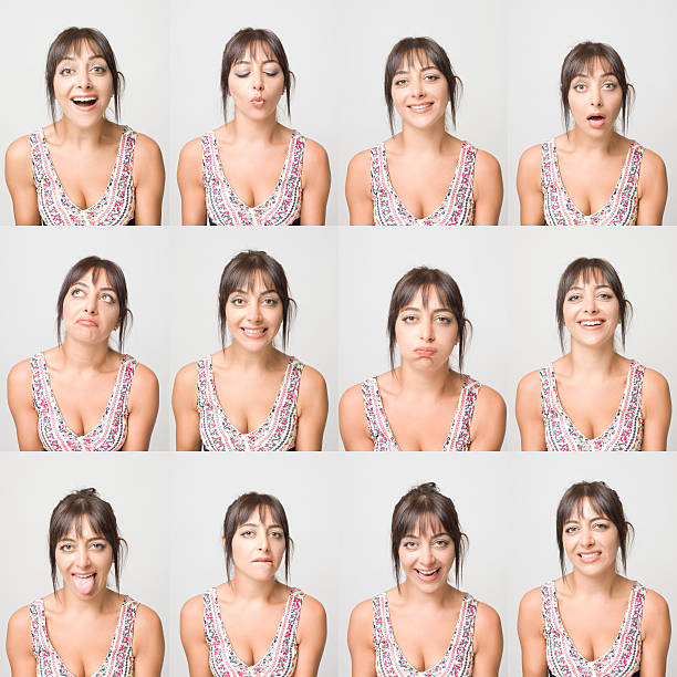 Real young woman making facial expressions stock photo
