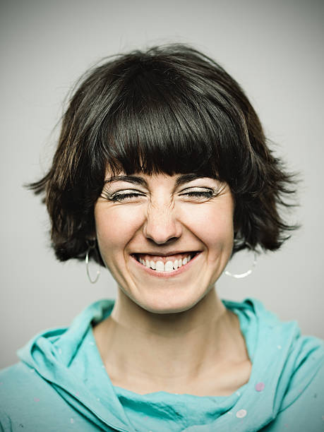 Real young woman. Real young spanish woman portrait laughing. cheesy grin stock pictures, royalty-free photos & images
