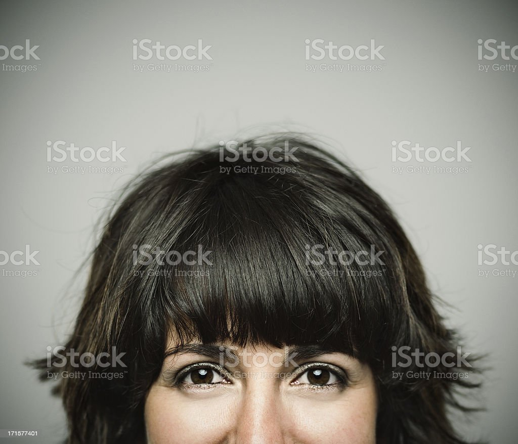 Real young woman. Real young spanish woman smiling. Half face 20-24 Years Stock Photo