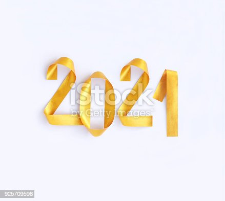 845307398istockphoto Realistic 3D isolated gold colored New Year shapes twisted in 2021 numbers on white paper background - original greeting card 925709596