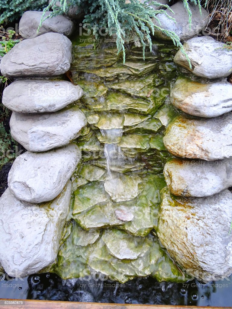 Realistic artificial moulded fibreglass waterfall, grey-stone, polyresin plastic waterfall image stock photo