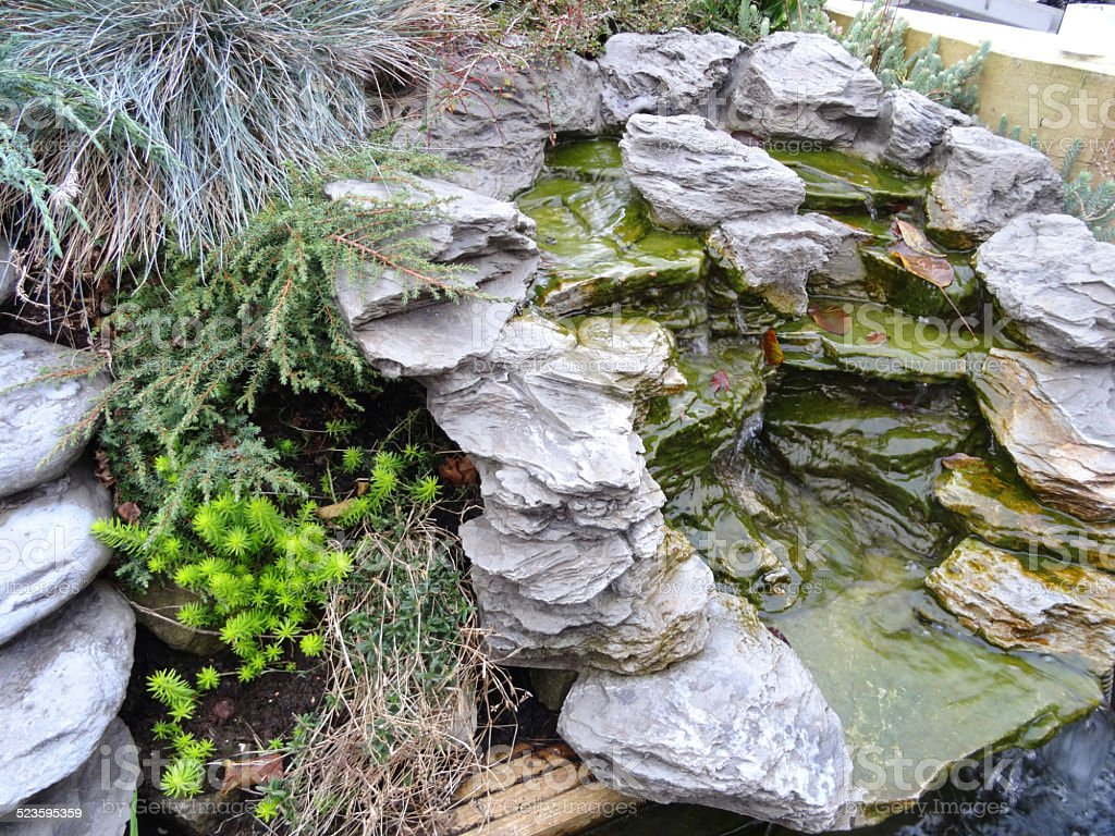 Realistic artificial moulded fibreglass waterfalls, grey-stone, polyresin plastic waterfall image stock photo