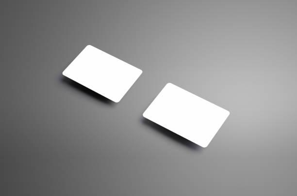 realistische leere vorlage zweier eine bank geschenkkarten mit schatten auf grauem hintergrund. - gutschein ausdrucken stock-fotos und bilder