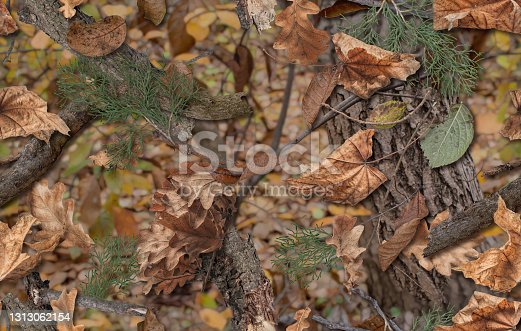 istock Realistic camouflage seamless pattern. Hunting camo for cloth, weapons or vechicles. 1313062154