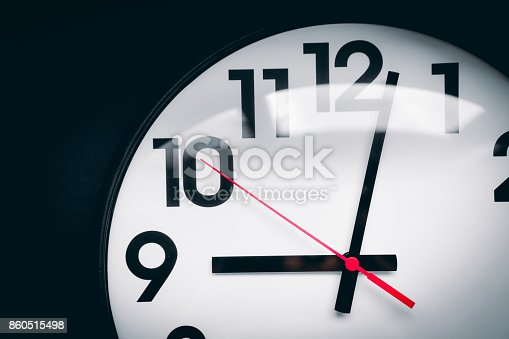 812823858istockphoto Realistic classic dark and white round wall clock, isolated on black background. 860515498