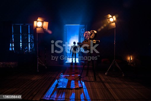 A realistic dollhouse living room with furniture, door and window at night. Horror movie backstage concept. Selective focus.