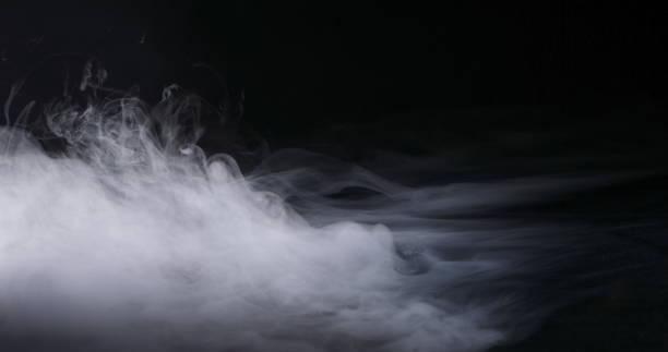 realistic dry ice smoke clouds fog - ice on fire foto e immagini stock