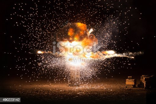 istock Realistic fiery explosion busting over a black background 490223142