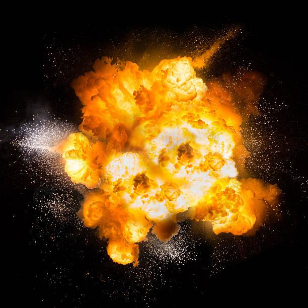 realistische feurigen explosion abweisenden auf schwarzem hintergrund - feuerkugel stock-fotos und bilder