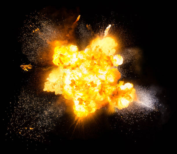 Realistic fiery explosion over a black background Realistic fiery bomb explosion with sparks and smoke isolated on white background burst stock pictures, royalty-free photos & images