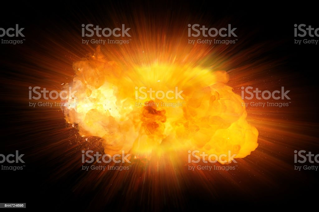 Realistic fire explosion, orange color with sparks isolated on black background stock photo