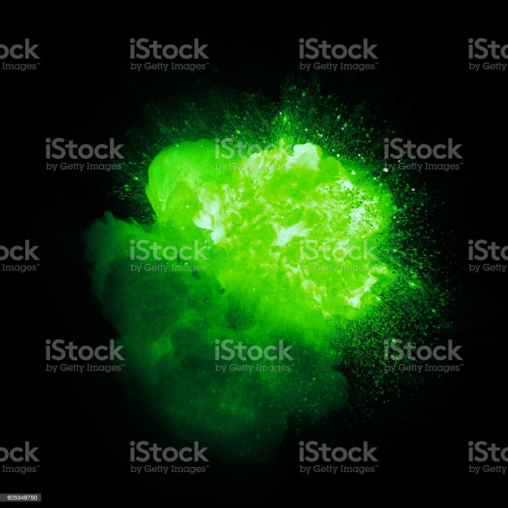 Realistic green plasma explosion with sparks and smoke isolated on black background stock photo