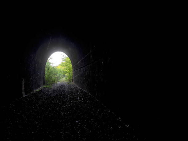 Realistic light at the end of the tunnel. Exit etc. stock photo