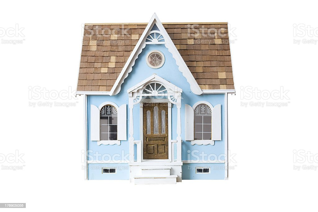 Realistic looking wooden dollhouse isolated on white with clipping path stock photo