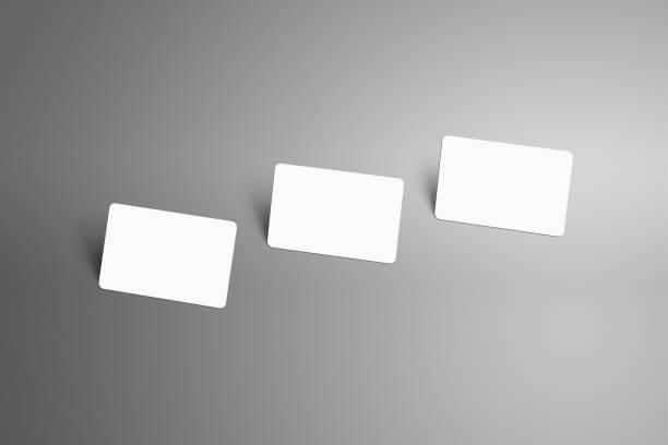 realistische nachbildung einer drei scheckkarte (geschenk) mit schatten auf grauem hintergrund. - gutschein ausdrucken stock-fotos und bilder