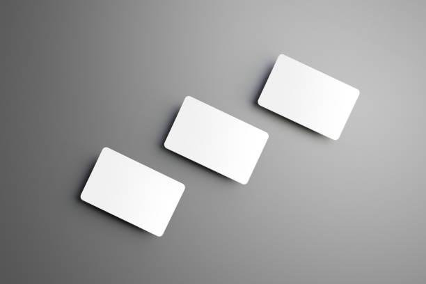 realistische nachbildung der drei (geschenk) bankkarte isoliert auf einem grauen hintergrund. - gutschein ausdrucken stock-fotos und bilder