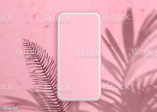 Photo of Realistic modern smartphone on pastel pink background. Mock up for game design, mobile application, wallpapers, websites. Plant shadows.