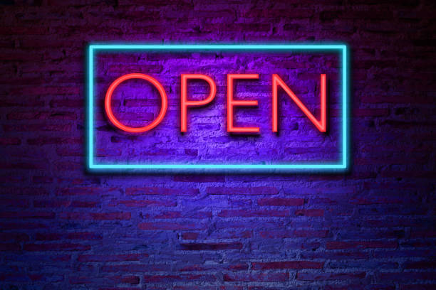 realistic neon text open on the brick wall. - open sign stock pictures, royalty-free photos & images