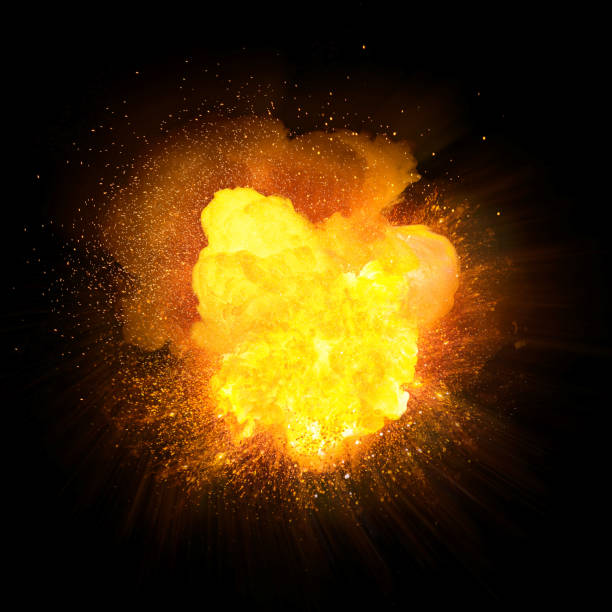 Realistic orange fire explosion with sparks isolated on black background stock photo