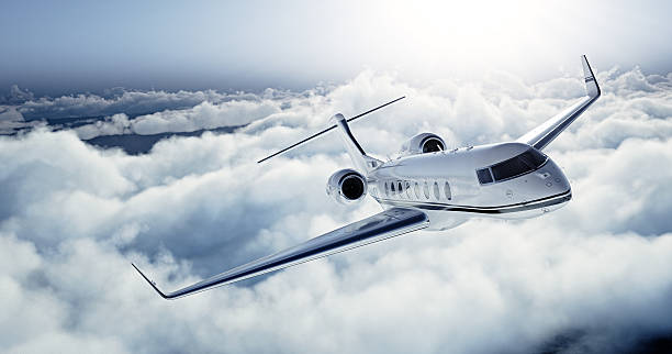 Realistic photo of White Luxury generic design private jet flying stock photo