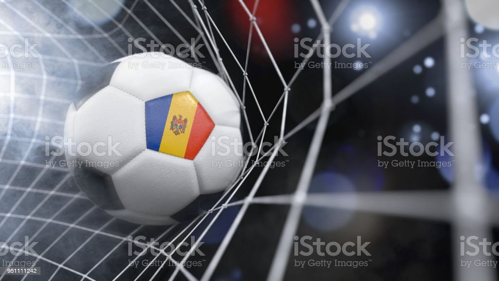 Realistic soccer ball in the net with the flag of Moldova.(3D illustration series) stock photo