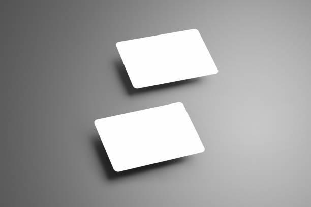 realistische weißen mock-up von zwei bank (geschenk) karten auf einem grauen hintergrund isoliert. - gutschein ausdrucken stock-fotos und bilder