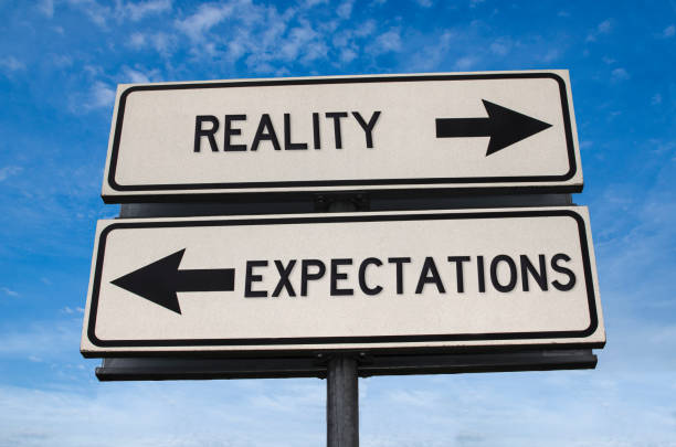 Reality vs expectation. White two street signs with arrow on metal pole with word Reality vs expectation. White two street signs with arrow on metal pole with word. Directional road. Crossroads Road Sign, Two Arrow. Blue sky background. Two way road sign with text. anticipation stock pictures, royalty-free photos & images