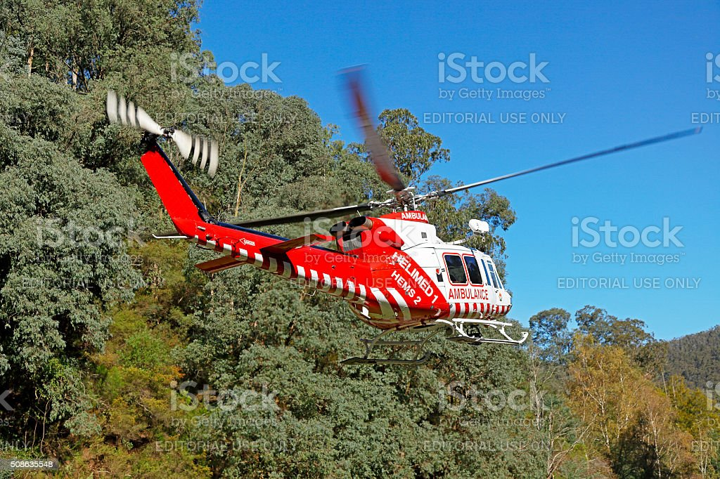Real-life emergency medical evacuation by air ambulance helicopter stock photo