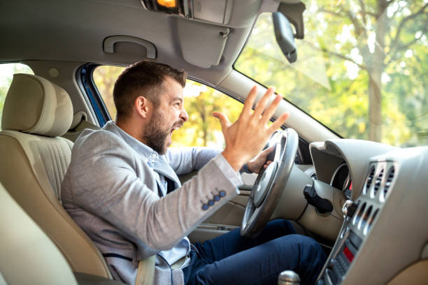 Really angry driver behind the steering wheel stock photo