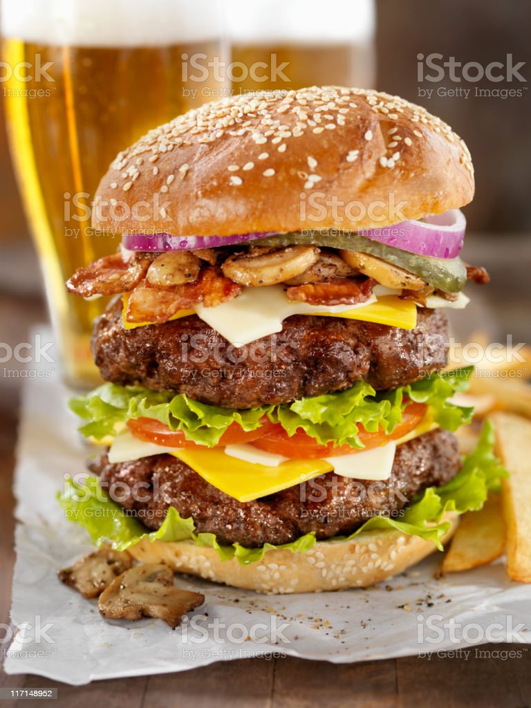 Really Big Burger with a Beer royalty-free stock photo