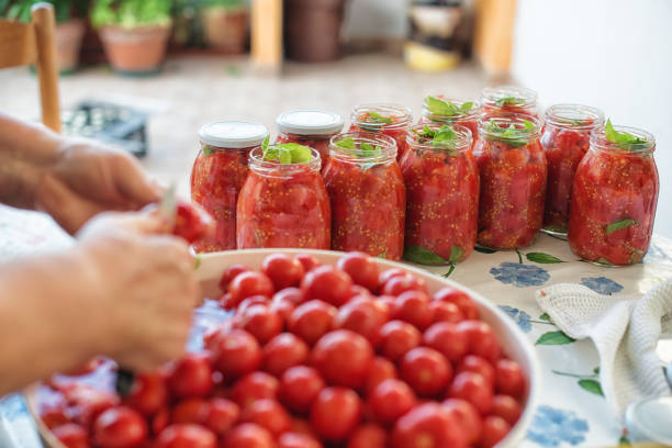 really italian handmade tomato sauce - tomato can stock photos and pictures