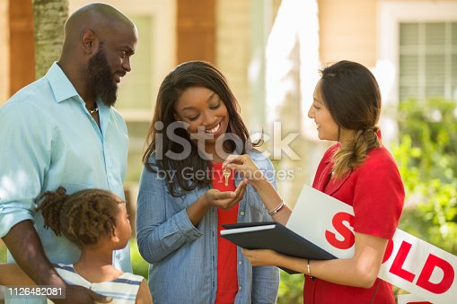 istock Realtor and family looking at new home to purchase. 1126482081