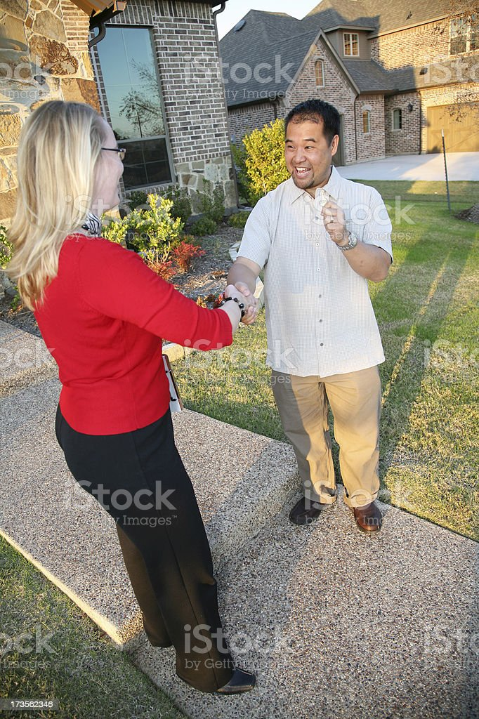 Realtor Closing the Deal with New Home Owner royalty-free stock photo