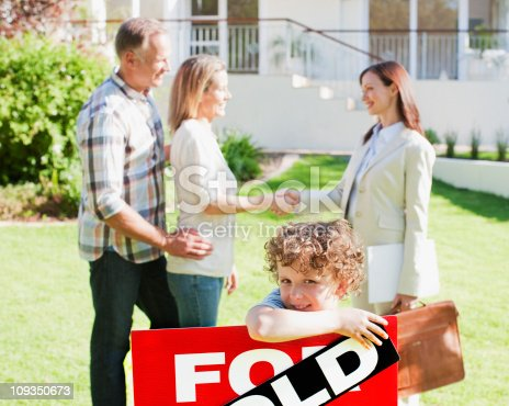 istock Realtor congratulating family on buying new house 109350673
