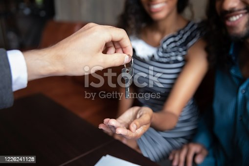 istock Realtor give keys to excited couple renters 1226241128