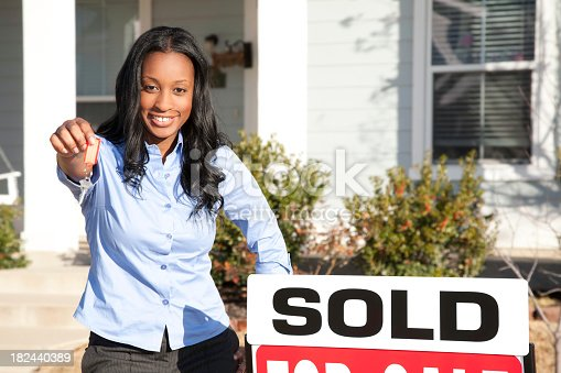 istock Realtor Holding Out Keys for New Home Owner 182440389