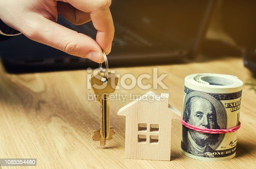 684793898 istock photo Realtor holds house keys. Real estate agent. Buying and selling a house, apartment. Home. Affordable housing. Investment in construction. Planning a new project. Property valuation. Selective focus 1083354460
