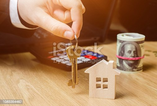 684793898 istock photo Realtor holds house keys. Real estate agent. Buying and selling a house, apartment. Home. Affordable housing. Investment in construction. Planning a new project. Property valuation. Selective focus 1083354462