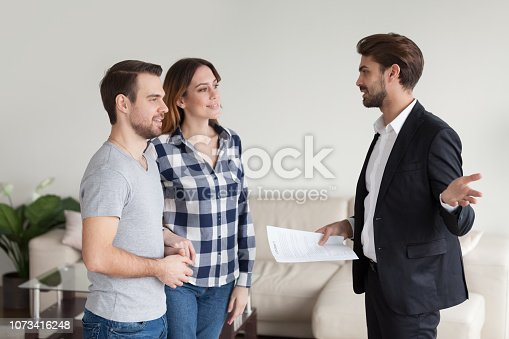 963814372istockphoto Realtor, landlord consulting, explaining terms of contract 1073416248