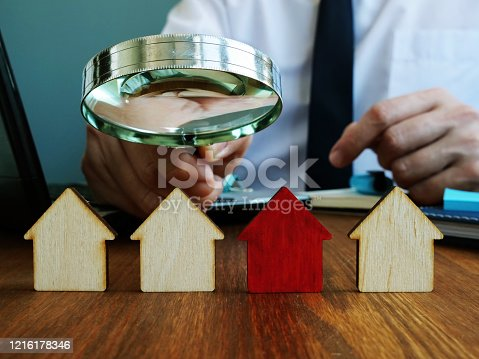 Realtor looking for home. Real estate investment trusts REITs investing concept.