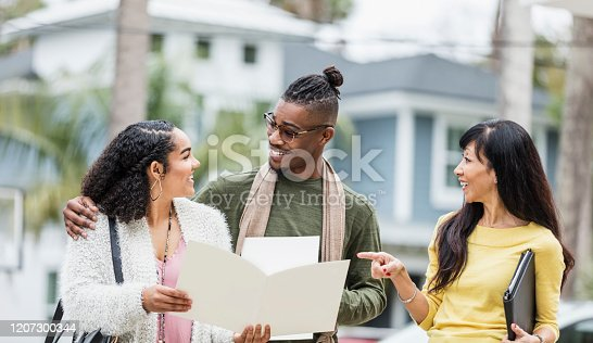 istock Realtor meeting with young African-American couple 1207300344