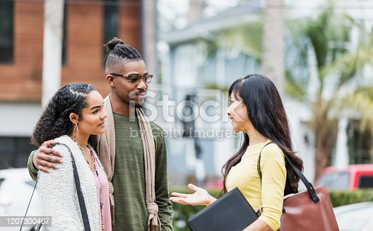 istock Realtor meeting with young African-American couple 1207300467