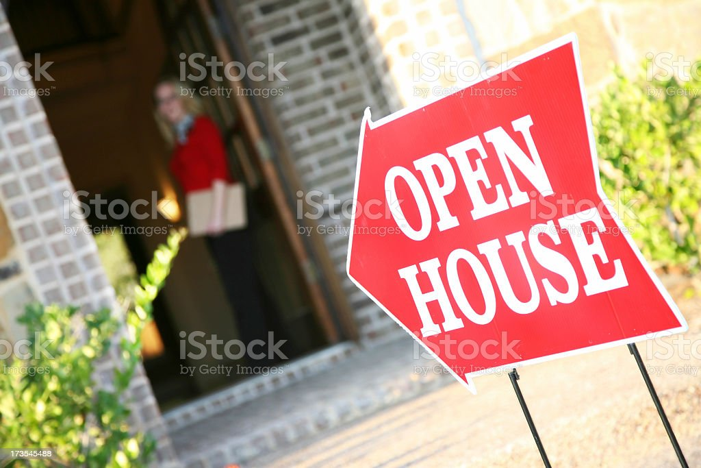 Realtor Opening Door at an Open House stock photo