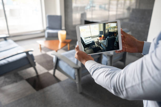 Realtor showing a property through an online video call stock photo