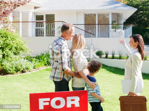 istock Realtor showing family a house for sale 109350685