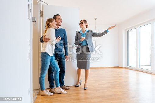 Realtor showing house to a young couple wanting to rent it