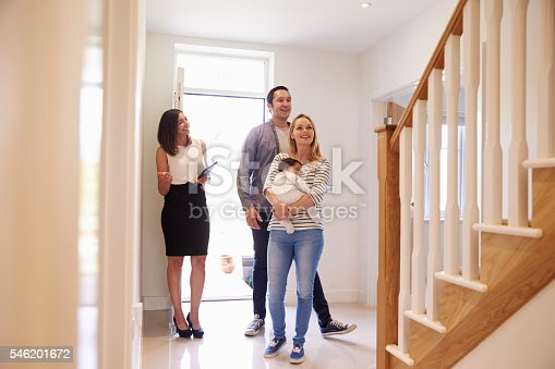 istock Realtor Showing Young Family Around Property For Sale 546201672